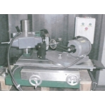 GRINDING MACHINE FOR MAINTAINING DIAMOD IMPREGNATED PROFILE WHEELS
